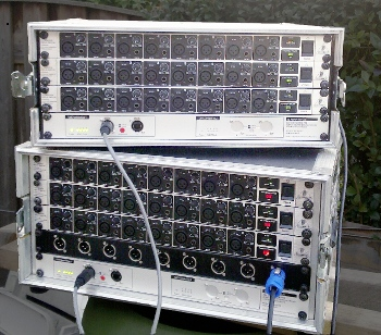 Two 32-channel stageracks with ADX-32B and ADA8000's